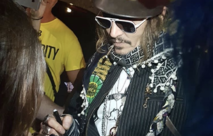 Johnny Depp signing autographs in his U-jack scarf